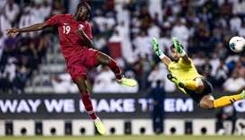 Qatar's forward Almoez Ali scores a goal during the second round Group E qualification football