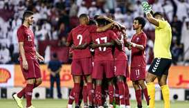 Qatar's players celebrate after scoring a goal against Afghanistan during the second round Group E q