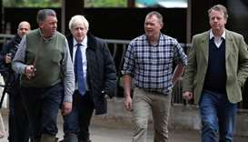 Britain's Prime Minister Boris Johnson, Farmer Peter Watson, David Watson and Scottish Secretary Ali