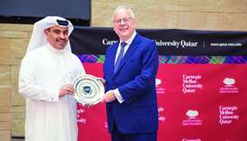 HE al-Kuwari receiving a souvenir from Michael Trick, dean of CMU-Q.