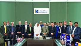 Doha Bank CEO Dr R Seetharaman and senior management officials hosting a business delegation from Ch