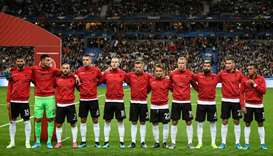 Albania's players stand during the national anthems ceremony