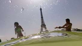 People cool off at the Trocadero Fountains next to the Eiffel Tower in Paris, as a heatwave hits Eur