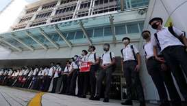 Hong Kong school children form human chain after weekend of protests