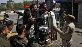 Kashmiri Shia Muslims shout slogans as they are detained by Indian police while trying to participat