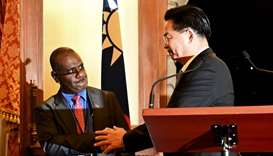 Taiwan's Foreign Minister Joseph Wu (R) shakes hands with Solomon Islands' Foreign Minister Jeremiah