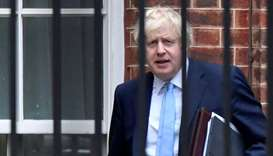 Britain's Prime Minister Boris Johnson leaves Downing Street from the rear entrance door, in London
