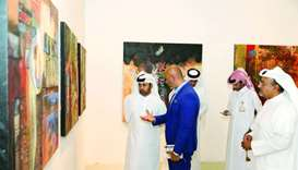 Artist Ali Ghaddaf briefs Dr Khalid bin Ibrahim al-Sulaiti on his works.