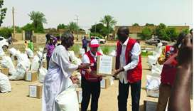 QRCS distributes relief assistance to flood victims in Khartoum