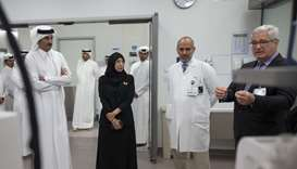 His Highness the Amir Sheikh Tamim bin Hamad al-Thani listens to a briefing about the treatment and