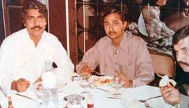 Islam, left, with friends in a restaurant. He said that during his earlier days he and his friends u