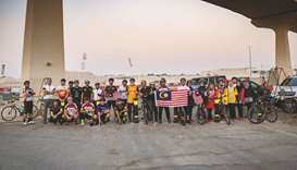 Malaysian community marks national days with bicycle ride