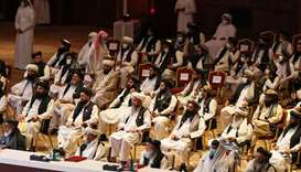 Members of the Taliban delegation attend the opening session of the peace talks in Doha.