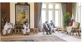His Highness the Amir Sheikh Tamim bin Hamad al-Thani meeting with the head of the Afghan Taliban's