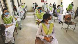 This picture taken earlier this week shows students at the Islamabad Model College of Commerce for G
