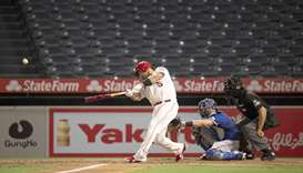 Los Angeles Angels designated hitter Albert Pujols hits a home run against the Texas Rangers during
