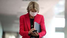 Wearing a face mask to reduce the risk posed by the coronavirus, Sen. Lisa Murkowski (R-AK) arrives