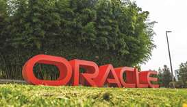 Signage is displayed outside the Oracle Corp headquarters campus in Redwood City, California. Oracle