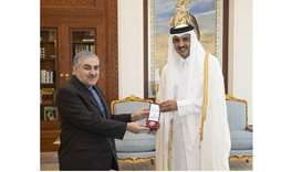 His Highness the Amir Sheikh Tamim bin Hamad al-Thani with the Ambassador of Iran.