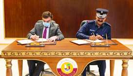 Maj-Gen Abdullah Mohamed al-Suwaidi and Dr Javaid Sheikh. sign the agreement