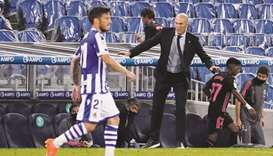 Real Madrid coach Zinedine Zidane (right) during the La liga match against Real Sociedad in San Seba