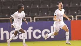 Al Sadd's Baghdad Bounedjah (right) celebrates his goal during the AFC Champions League Group D matc