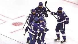 Tampa Bay Lightning players celebrate after defeating Dallas Stars in the Game Two of the 2020 NHL S