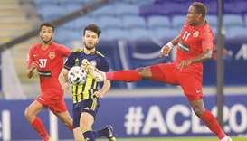 Shabab Al Ahli (in red) played out a draw with Pakhtakor (in blue and yellow) on Sunday. PICTURE: No