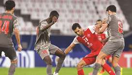 Al Duhail's Almoez Ali (left) and teammate Luiz Junior (right) vie for the ball with Persepolis' Vah