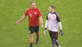 Bayern Munich coach Hansi Flick (left) and Manuel Neuer during their training session in Budapest ye