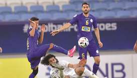 Esteghlal's Mehdi Ghaedi (left) vies for the ball with Al Ahli Saudi's Hussein Abdulghani (centre) a