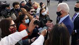 US Democratic presidential candidate Joe Biden speaks to reporters upon his departure after campaign