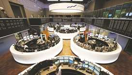 Traders monitor data on computer screens at the Frankfurt Stock Exchange. The DAX 30 closed down 1.1