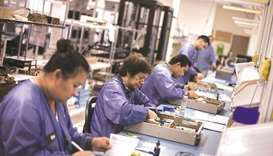 Employees assemble servers at the Z Microsystems manufacturing facility in San Diego, California. Or
