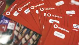 Vodafone Idea SIM card packets are arranged for a photograph at a store in Mumbai. Vodafone Group wo