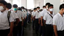 People stand in a queue at the Job Expo Thailand 2020.