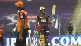 Shubman Gill of Kolkata Knight Riders raises his bat after reaching his fifty against Sunrisers Hyde