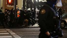 Police clash with Portland protesters and press; more than 20 arrested