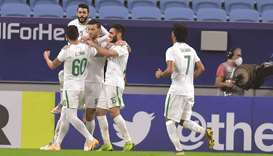 Al Ahli Saudi's Omar al-Soma (centre) celebrates after scoring a goal with his teammates during the