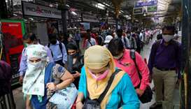 People wearing protective face masks leave the Chhatrapati Shivaji Terminus railway station.