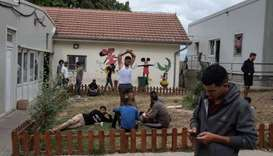 Migrants take a rest at One Stop Center for Migrants, near the border with Hungary in Subotica, Serb