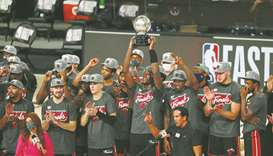 Miami Heat forward Bam Adebayo holds up the Eastern Conference Championship trophy after defeating t