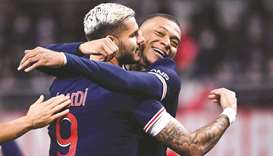 Paris Saint-Germain's Argentinian forward Mauro Icardi (left) celebrates with teammate Kylian Mbappe