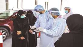 HE Dr Hanan Mohamed al-Kuwari, Minister of Public Health, at a drive-through testing centre.