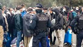 French police evacuate some 800 migrants after they dismantled their camp located near the hospital