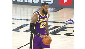 LeBron James of the Los Angeles Lakers dribbles the ball during the fourth quarter against the Denve
