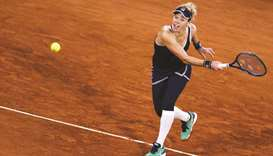 Germany's Laura Siegemund returns the ball toa France's Kristina Mladenovic (below) during their Fre