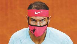 Spain's Rafael Nadal wears a protective face mask before his first round French Open match at Roland
