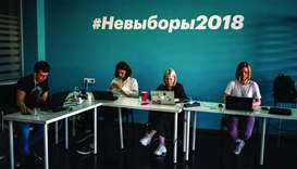 Employees of Navalny's Anti-corruption Foundation (FBK) work at their office in Moscow