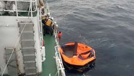 Filipino crew member of Gulf Livestock 1 is rescued by Japan Coast Guard crew on vessel Kaimon, at t